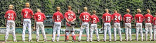 high school baseball team lined up for national anthem